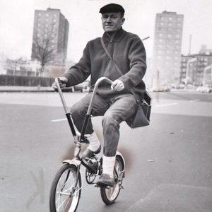 E.G. Marshall rides a bike.