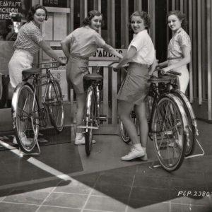 Kathleen Burke, Mari Colman, Grace Bradley and Lona Andre park bikes.