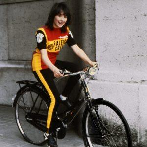 Isabelle Adjani rides a bike.