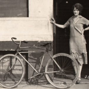Helen Freeman stands by a bike.