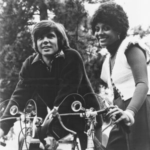 John Davidson and Leslie Uggams ride bikes.