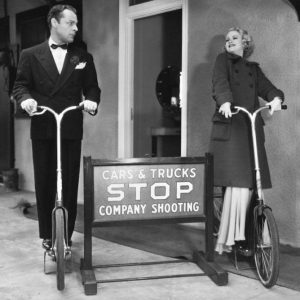 Brian Donlevy and Claire Trevor ride Ingo-Bikes.