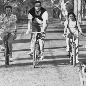 Romy Schneider, Philippe Noiret and Catherine Delaporte ride bikes.