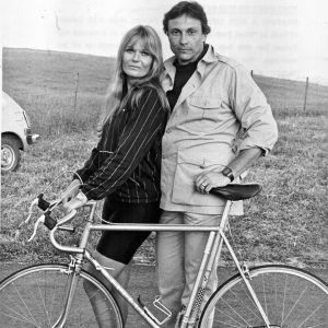 Valerie Perrine and David Ackroyd hold a bike.