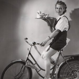 Siri Olson rides a bike — with coffee.