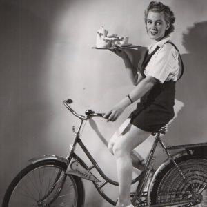 Siri Olson rides a bike — with coffee.