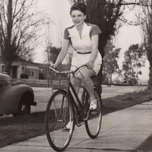 Joan Leslie rides a bike.