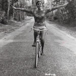 Daliah Lavi rides a bike.