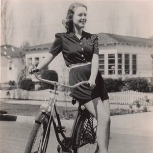 Doris Davenport models a bike.