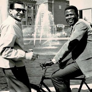 Sidney Poitier rides a bike, Sydney Pollack directs.