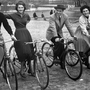 Bing Crosby, Nicole Maurey, Claude Dauphin and Maria Mauban ride bikes.