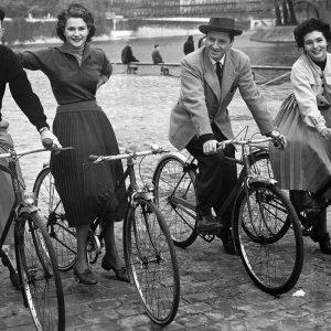 Bing Crosby, Nicole Maurey, Claude Dauphin and Maria Mauban ride bikes.