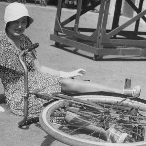 Arline Judge falls off a bike.