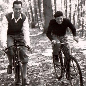Richard E. Grant and Fred Ward ride bikes.