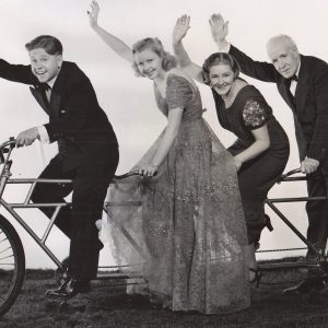Mickey Rooney, Cecilia Parker, Fay Holden and Lewis Stone ride a bike.