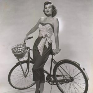 Virginia Mayo poses with bike.