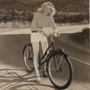 Martha Tilton rides a bike.