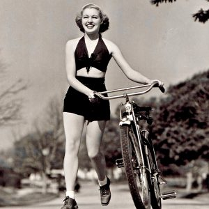Mary Beth Hughes runs with a bike.