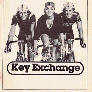 Mark Blum, Brooke Adams and Ben Masters ride bikes.