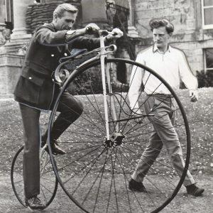 Lloyd Bridges rides a bike.