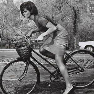 Claudia Cardinale rides a bike in Central Park.