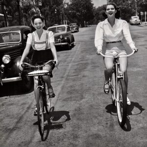 Dorothy Morris and Frances Rafferty ride bikes.