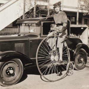 Gwen Lee rides a bike.