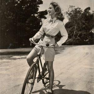 Janet Leigh rides a bike.