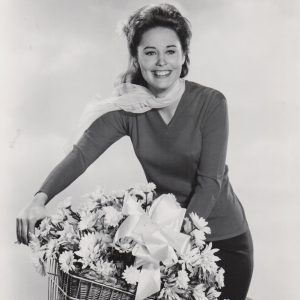 Cheryl Miller rides a bike, florally.