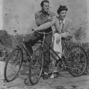 Louis Hayward and Ida Lupino ride bikes.