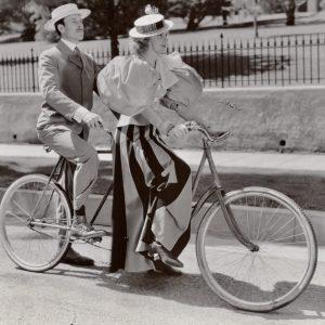 Allyn Joslyn and Carole Landis ride a bike.