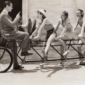 Robert Montgomery, Jean Parker, Irene Hervey and Jean Howard ride a bike.