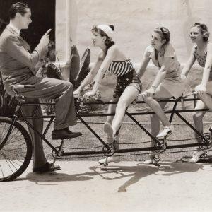 Robert Montgomery, Jean Parker, Irene Hervey and Jean Howard ride a bike.