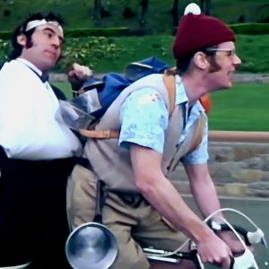 Terry Jones and Michael Palin ride a bike.