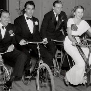 Cesar Romero, Gilbert Roland, Douglas Fairbanks Jr. and Betty Furness race bikes.
