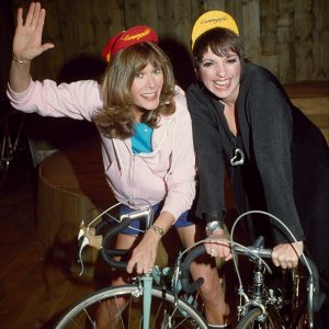 Kate Jackson and Liza Minnelli ride bikes.