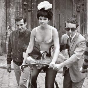 Geneviève Bujold rides a bike.