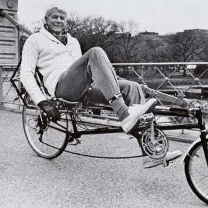 Peter Graves rides a bike, recumbently.