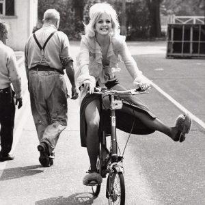 Goldie Hawn rides a bike.