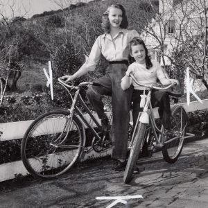 Virginia Bruce and daughter Susan Ann ride bikes. Happy Mother's Day!