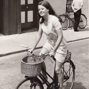 Sarah Miles rides a bike.