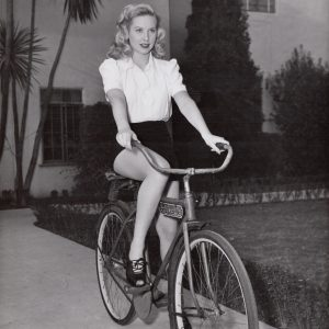 Penny Edwards rides a bike.
