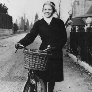 Juliet Mills walks a bike.