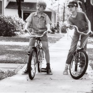 Macaulay Culkin and Anna Chlumsky ride bikes, Howard Zieff directs.