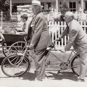 Lauritz Melchior and Jimmy Durante ride a bike.