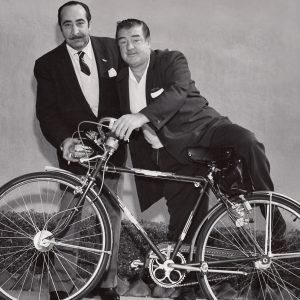 Lou Costello mounts a bike, Adolphe Wenland gives it away.