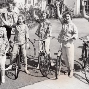 Robert Cummings and family ride bikes.