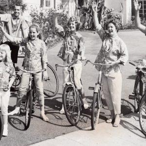 Robert Cummings and family ride bikes.