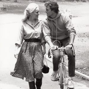 Patrick Cassidy rides bike, Tuesday Weld walks.