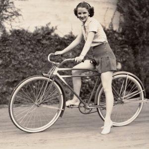 Florine McKinney rides a bike.